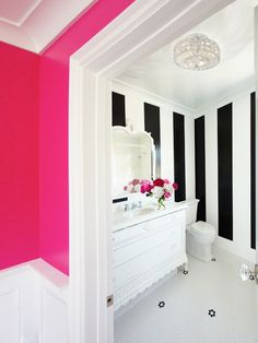 I LOVE the black and white stripes with the hot pink wall... I wonder if my landlord would mind this look for my bedroom...