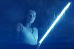 Ignite the blue - Here, we see a new image of Daisy Ridley's Rey wielding what was once the Skywalker family lightsaber. Fans can await a laser-sword battle in the rain come Dec. - Star Wars: The Last Jedi Star Wars Watch, Rey Star Wars, Star Wars Art, Image Fun, New Image, Star Wars Episode 8, Color In Film, Star Wars Girls, Star Wars Costumes