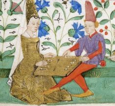 Couple playing a game in the margins of a French Book of Hours (ca. 1460)