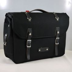 Intrans in black. Philosophy Bags (as seen in Sierra). Bike bag can accommodate a laptop.