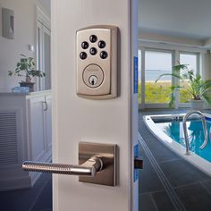 Soho electronic deadbolt and the Couture lever from Baldwin hardware.