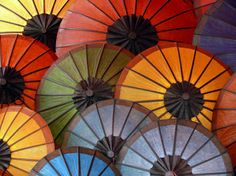 Photograph by Dimitris Koutroumpas, My Shot A rainbow of colorful umbrellas brightens a gray day in Luang Prabang, Laos.