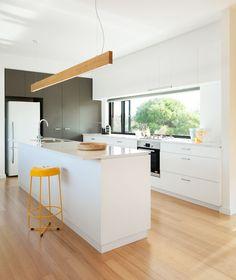 White kitchen with grey cabinet feature & window splash back