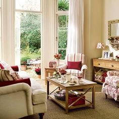 Cherry red and cool chalk white living room. Informal, cozy look for a smaller room.