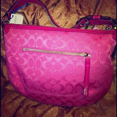 AUTHENTIC Coach Hobo Signature Bag HOT PINK Excellent ~ like new Authentic Coach Bag in Hot Pink. Used a couple times only. You will love it. Leather strap and zipper pull ~ signature C canvas ~ zipper top closure - inside Creed and serial number. No rips, years, or stains. Priced to sell. Any questions please ask!! Coach Bags Hobos