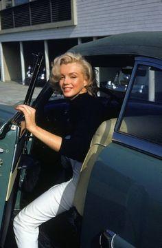 Marilyn Monroe getting out of a car in  Hollywood, CA, US ~photo taken May 1953 by Alfred Eisenstaedt