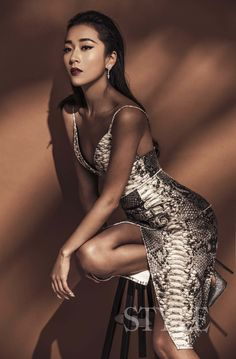Singer and actress Jike Junyi in Ermanno Scervino SS15 python print brassiere and matching skirt in Styles Beauty January issue #ScervinoEditorials #ErmannoScervino