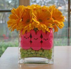 dollar store centerpiece . vase $1 , egg candy 1$ , flowers 1$