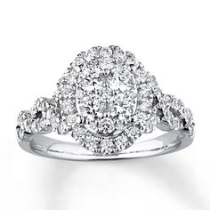 Kay Jewelers halo ring with winding band. Wedding rings go above and below the setting. Love, love, love, love it.