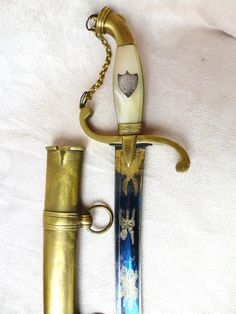 Marine Dagger,  Restauration period, 19th Century. Handle wafer pearl and brass inlay. Geniune piece. For sale on Proantic by Le Lys et l'épée. We love collecting extraordinary objects at Renaissance Fine Jewelry and Renaissance Fine Antiques of New England in Vermont or at www.vermontjewel.com. Ruby Lane or Ebay.