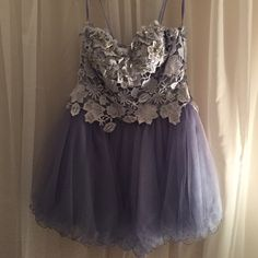 Lavender laceup prom dress with lace, tule &jewels Worn once in perfect condition short prom dress with thin straps and a lace up corset like back. Beautiful dress. Marked as size 3/4 **Nof actually Sheri hill just tagged for visibility Sherri Hill Dresses