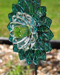 "Repurposed Glass Garden Flower, Wall Art, Garden Art - Made of Vintage Glass Plates ""Pixie"" Iridescent Turquoise Flower. $50.00, via Etsy."