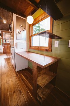 Tiny house with home office area. The Mayflower by Wind River Tiny Homes.