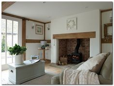 Border Oak new build timber framed houses. I like the clean, simple look of this room. Cottage Lounge, Cottage Living Rooms, Cottage Interiors, Home Living Room, Inglenook Fireplace, Brick Fireplace, Fireplace Ideas, Cottage Fireplace, Fireplaces