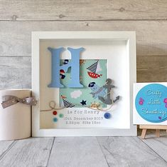 Beautiful and unique personalised box frame in a Nautical theme, by Crafty Little Somethings. Personalised box frames that make a lovely gift, keepsake, or to complete your childs nursery/bedroom decor. Frames will be made with: - A hand painted MDF initial in Victoria font - Cotton Box Frame Art, Shadow Box Frames, Nursery Decor Boy, Bedroom Decor, Scrabble Frame, Baby Frame, Personalised Frames, Frame Crafts, Christening Gifts