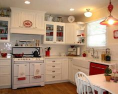 Love all the white with pops of red attire! Maybe green walls and green backs in the cupboards?