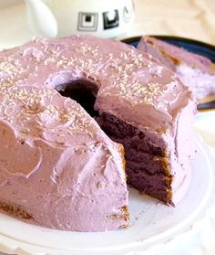 Ube Chiffon Cake is a soft, moist and fluffy cake that is frosted with whipped cream cheese icing and topped with some shredded coconut.