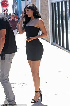 Hourglass: Kylie's Balmain number accentuated her figure turning heads as she stood beside her security team