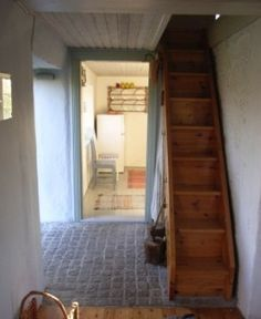 Narrow stairs to the attic ... something like this to convert the attic into something usable