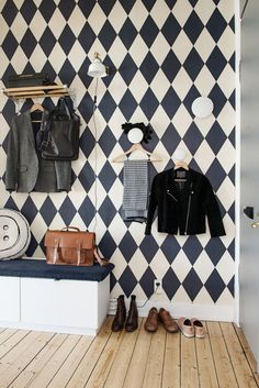 Black and white wallpaper on hallway wall