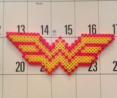 Wonder Woman in Perler Beads Awesome. Your choice of Necklace, Keychain, Pin or… Perler Beads, Fuse Beads, Pearler Bead Patterns, Perler Patterns, Nerd Crafts, Kids Crafts, 8bit Art, Iron Beads, Melting Beads