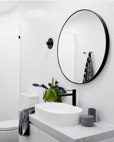 Round mirrors in bathrooms are sooooo beautiful... the perfect way to soften hard lines and create interest Another bathroom beauty by @gia_renovations