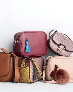 Question: What can you give everyone without getting anyone the same thing? Answer: A J.Crew Signet or Rider bag customized with colorful key fobs, faux-fur pom-poms (!) and tassels with Italian beads. Start purse-onalizing theirs (or yours) at jcrew.com.
