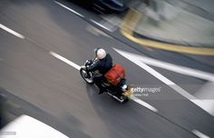 Foto de stock : Motorcycle courier or Pizza delivery speeding