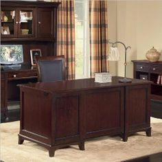 Wynwood Kennett Square Executive Desk by Wynwood. $1072.95. Kennett Square has an urban influence that is apparent in its clean lines, subtle framed panels and flared legs. Round knobs define the design with their contemporary champagne nickel finish. This unique group features a Dark Chocolate finish on cherry veneer with poplar solids. Features Made of cherry veneer with poplar solids Round knobs define the design with their contemporary champagne nickel finish...