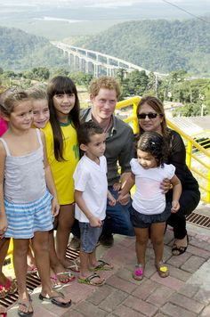 Prince Harry poses with local children from a village during a trip to the Atlantic Rainforest on June 25, 2014 near Sao Paulo, Brazil.
