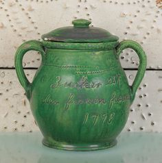 "Realized Price: $ 10665   Pennsylvania redware covered sugar, dated 1798, inscribed Zucker est der frauen fraund (sugar is the woman's friend), 7 1/2"" h. Provenance: Family of Arthur Sussel."