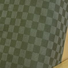Checkered Spruce futon cover is classically styled woven design . Offers one inch checkered color on color pattern in solid spruce. Linen appearance creates an ambiance bringing warmth and comfort in any room.