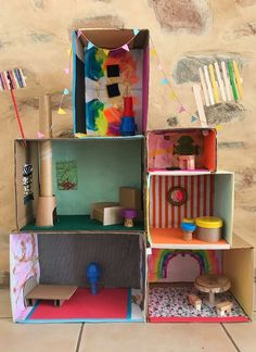 These boxes have been stacked up to make a miniature house. Kids Craft Box, Fun Crafts For Kids, Craft Activities For Kids, Projects For Kids, Diy For Kids, Activity Ideas, Recycling For Kids, Mini Craft, Cardboard Houses For Kids