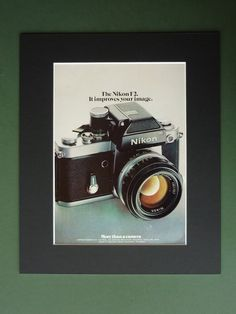 Vintage 1974 Nikon F2 Advertisement - Mounted Advert Print - SLR Camera - 35mm Lens - Mounted Ready To Frame - Matted - Photography - Film. £10.00, via Etsy.