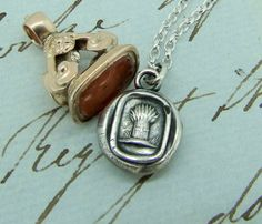 Items similar to harvesting your dreams, Antique wax seal impression, pendant and chain sterling silver. on Etsy
