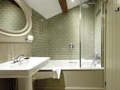Solus Ceramics worked with Oliver Redfern to supply tiles to this exclusive boutique hotel. Green, crackle glazed tiles from the Harlo range were used in the en suites. Attic Bathroom, Steam Showers Bathroom, Bathroom Wall, Modern Bathroom, Small Bathroom, Bathroom Ideas, Neutral Bathroom, Bathroom Trends, Bad Inspiration