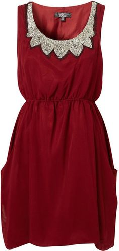 Red sleeveless dress with silver pretties
