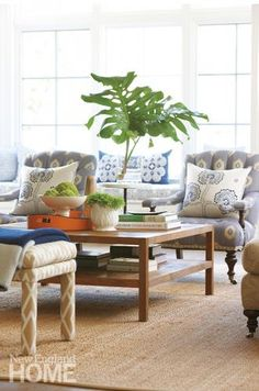 A large teak coffee table grounds this comfortably chic sitting area. Interior…