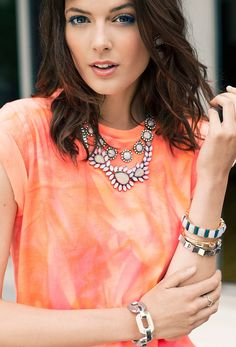 opal accents are the perfect complement for this bright top!