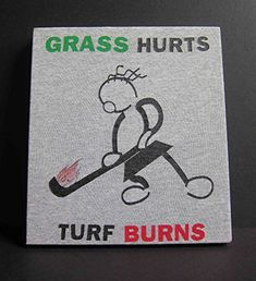 """Field Hockey T-Shirt Wall Art """"Grass Hurts, Turf Burns."""" Upcycled Retro Field Hockey Shirt becomes an original piece of art! """"Grass Hurts, Turf Burns"""" Retro Field Hockey T-Shirt Wall Art. 2014 by MyTeeArt My cousin Mary played Field Hockey all through College. I went to a lot of her games and cheered her on even at her opponents home field. Sometimes, her mom and I alone could out-cheer the whole https://sports.boutiquecloset.com/product/field-hockey-t-shirt-wall-art-grass-h"""