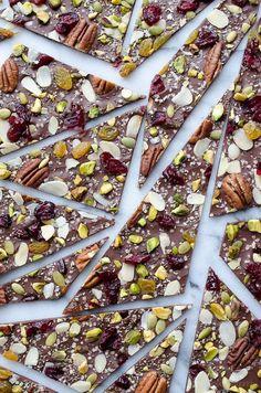 This Hippie Chocolate Bark is amazing! Dark chocolate loaded with fruits, nuts and seeds. Learn how to create chocolate bark with just one baking sheet. | Caroline | Taste Love & Nourish on TasteLoveAndNouri...
