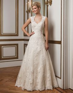 Justin Alexander wedding dresses style 8822 Classic A-line gown with a  Queen Anne neckline features hand placed beaded lace and point d esprit  underlay. b33254ba3bff