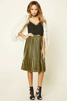A woven metallic skirt featuring allover pleats and a concealed side zipper.