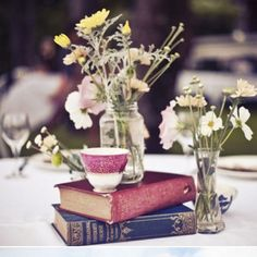 I like the idea of using vintage books for table decorations, they're both pretty and informative.