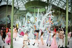 Chanel Spring 2015. In Paris, from the house of Chanel, tropical looks seem to dream of a warmer time, in a show in an arboretum of white cardboard palms. Valerio Mezzanotti for The New York Times