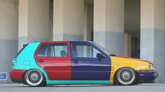 The 1996 VW Harlequin Golf is a four-colour car: each door panel, the two bumpers, the hood, and the roof were painted in either purple, yellow, teal, or red. No one panel could be touching another of the same colour.