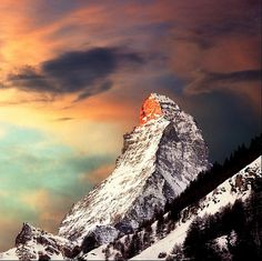 A new day - winter landscape    The Matterhorn (German), Cervino (Italian) or Cervin (French), is a mountain in the Pennine Alps. With its 4,478 metres (14,692 ft) high summit, lying on the border between Switzerland and Italy, it is one of the highest peaks in the Alps and its 1,200 metres (3,937 ft) north face is one of the Great north faces of the Alps.