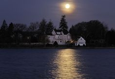 I usually try not to post multiples of the same subject, but the shots I got this morning of the super moon setting over the house on Argyle Pond were just too amazing. More will be posted next weekend.   Funny amazing laugh strange