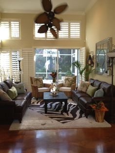 Palm ceiling fan and faux animal rug . . .J'adore Decor: British West Indies Style
