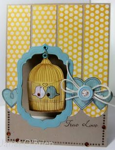 Love the suspended birdcage - Cute! by Janet O Brien